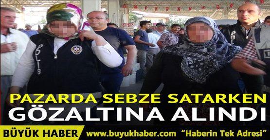 Pazarda sebze satarken gözaltına alındı
